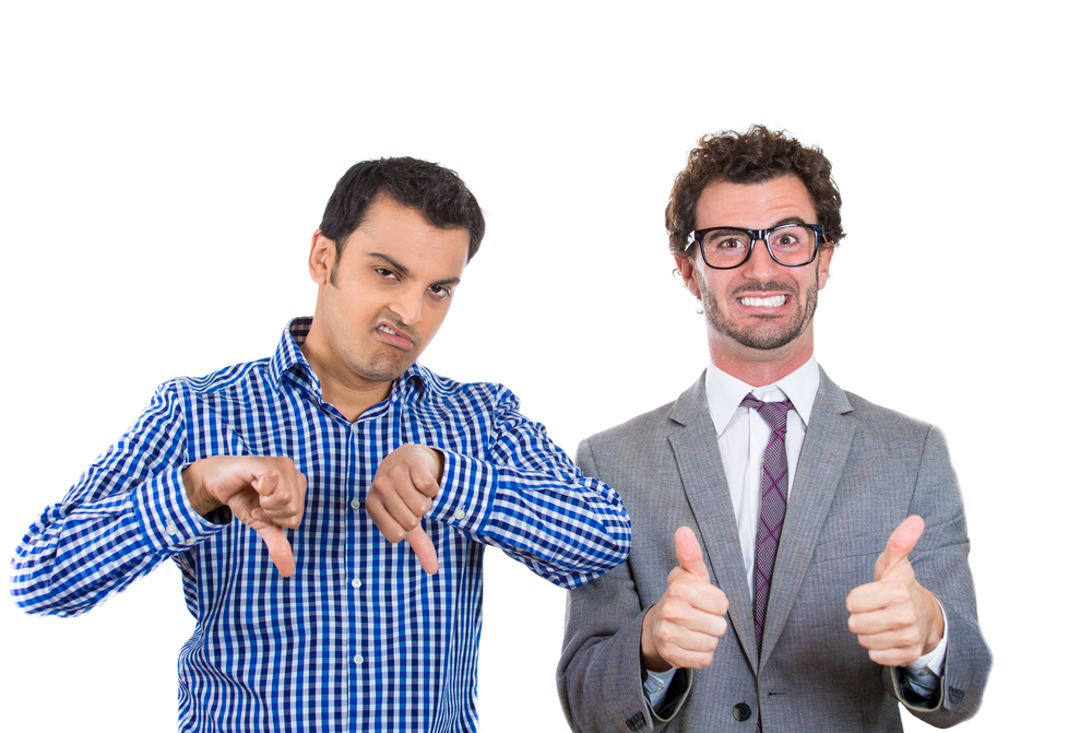 A portrait of two co-workers, a wall street businessman and a main street worker, one being negative and angry, the second one positive and optimistic, isolated on a white background. World polarity